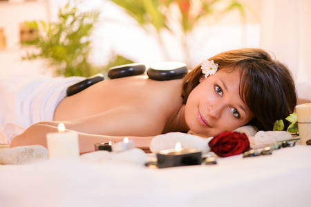 Young beautiful woman relaxing and enjoying at Lastone Therapy  photo