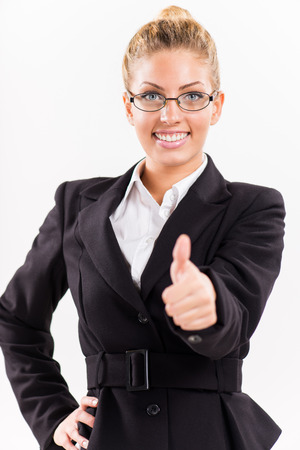 Portrait of attractive businesswoman showing thumbs up  Looking at camera  photo