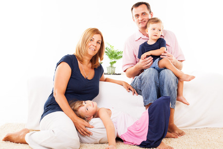Beautiful happy family sitting in the living room  photo