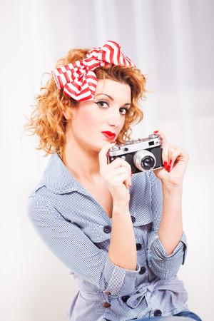 Portrait of elegant retro style womanhousewife with photo camera. photo