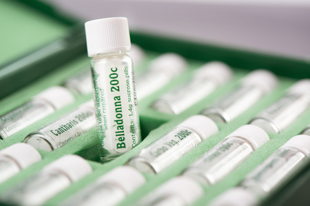 Closeup of bottles with homeopathic remedies. Belladonna pills.