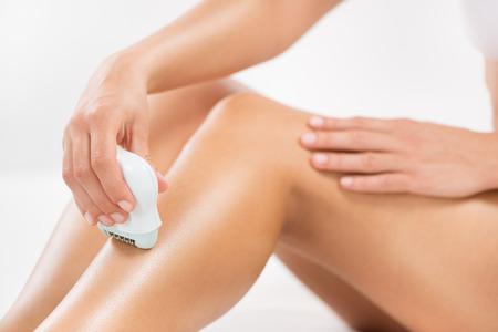 electric razor: Shaving legs with Electric Razor. Stock Photo