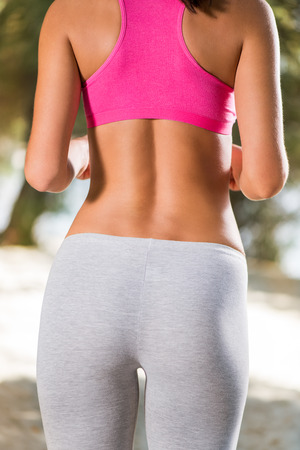 perfect female body: Perfect female body. She is running. Rear view. Stock Photo