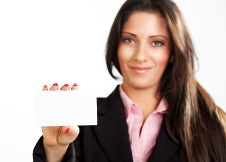 Businesswoman holding Blank business card. Selective focus. Focus on blank card. photo