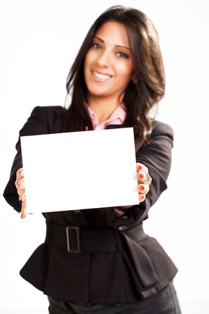 Businesswoman holding Blank card. Selective focus. Focus on blank card. photo