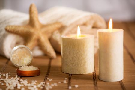 seastar: Tranquil scene with Towel, bath salt, Candle, and sea-star.