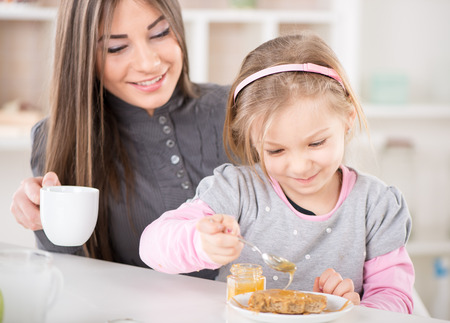 Mother and daughter breakfast in the kitchen.  Stock Photo - 26749175