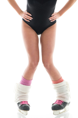 gaiters: Female legs in ice skate shoes on White background