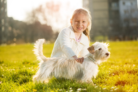 caress: Little girl caress with her puppy dog in the park