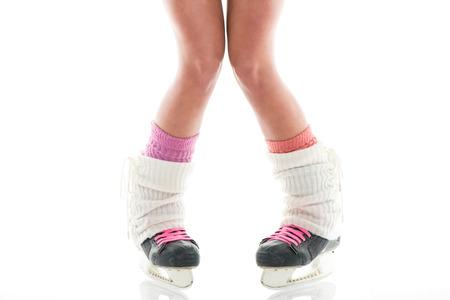 gaiters: Female legs in ice skates. White background