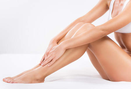 Bodycare of female Smooth legs. Stock Photo