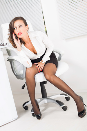 hot office pic. Hot Business Woman Talking On The Mobile Phone In Office Stock Photo - 27868837 Pic I