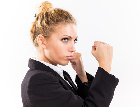 Angry Businesswoman boxing punching ready to fight. photo