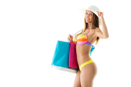 sun hat: Beautiful young woman in bikini with Sun Hat and holding beach bag. Isolated on white background Stock Photo