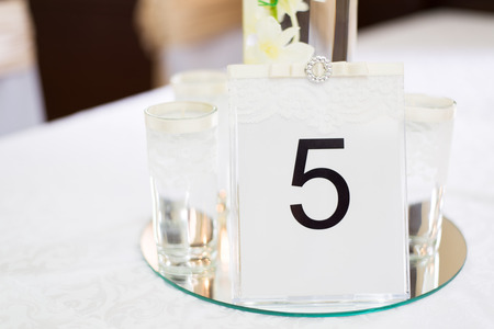 Place setting and card on a table at a wedding reception photo