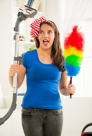 Portrait of a smiling young beautiful woman cleaning hause. photo