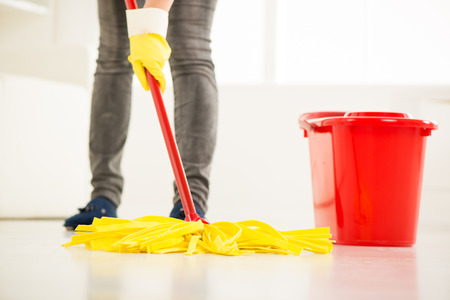 mop floor: Woman cleaning the house. Close-up with mop. Stock Photo