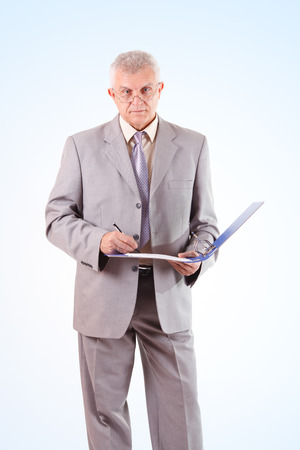 businessman signing documents: Successful Senior Businessman signing documents