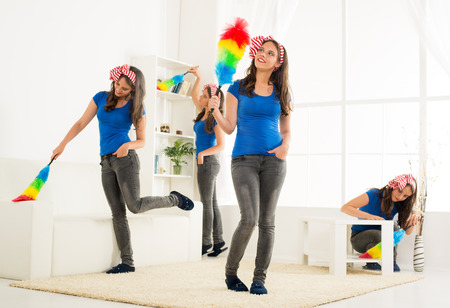 spring cleaning: Young beautiful maid cleaning the house