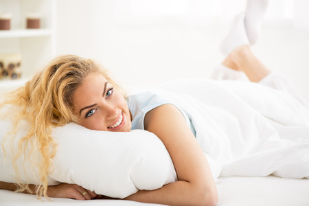Cute young beautiful girl at morning resting in the bed photo