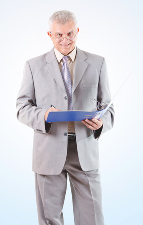 businessman signing documents: Smiling Successful Senior Businessman signing documents
