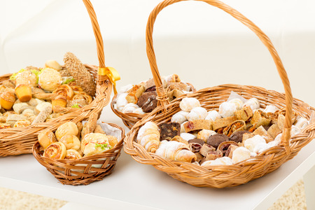 Wicker basket full of delicious sweet and savory baked goods.