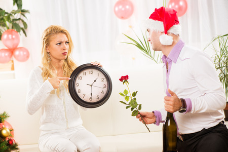 after midnight: Young woman is mad at her boyfriend who missed the New Year party.