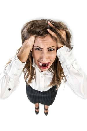 screaming face: Young businesswoman having problem and stressed pulling her hair. Stock Photo
