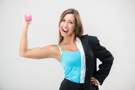 work life: Multitasking businesswoman balancing life work and fitness.