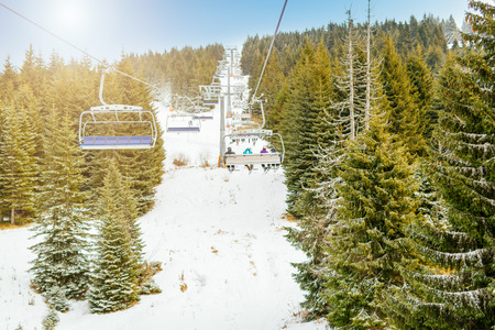 ropeway: Ropeway and chair lifts in driving at ski resort in nice sunny day. Landscape.