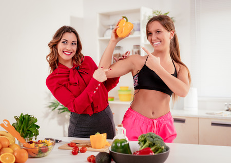 Young blogger woman talking about sport and healthy food with TV presenter.