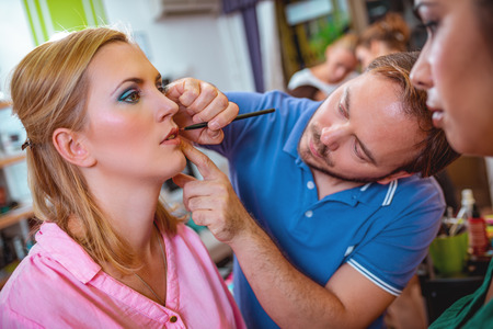 Makeup teacher is helping students training to become makeup artist.