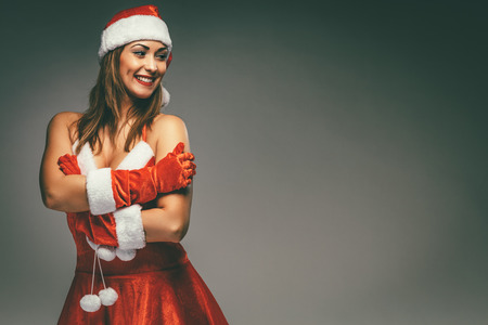 Beautiful young smiling woman in Santa Claus costume. Stock Photo