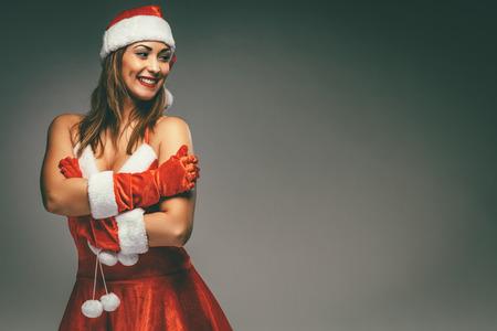 Beautiful young smiling woman in Santa costume. Фото со стока