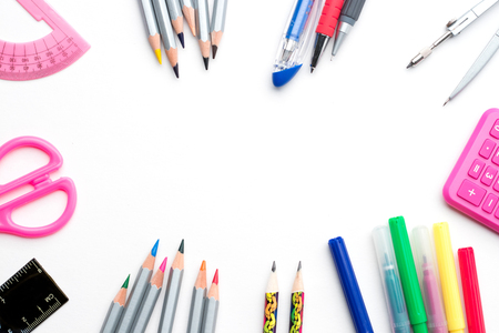 Back to school. Colorful school stationery framing isolated on white background - copyspace top view