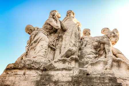 Rome ancient sculptures. Part of bridge. Excursion. Meaningful composition: sun and moon feelings and emotions on sky background