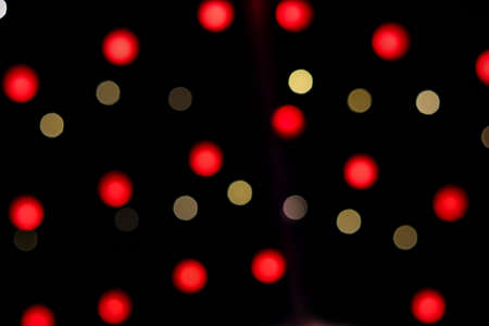 Bokeh yellow and red Christmas lights abstract photo for background
