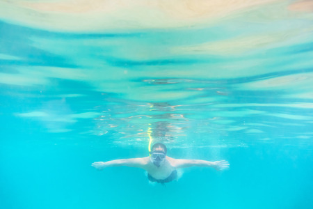 skin diving: Skin diving or snokerling at shallow of beach