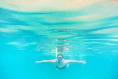 invade: Skin diving or snokerling at shallow of beach