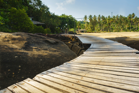 the sun and shade: wood bridge way with sun shade Stock Photo