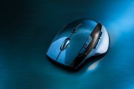 High technology computer gaming mouse in dark blue tone on the metal surface