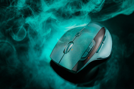 scroller: High technology computer gaming mouse in dark green tone with smoke Stock Photo
