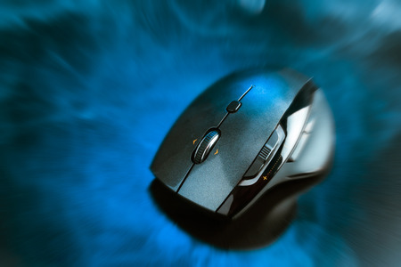 scroller: High technology computer gaming mouse in dark blue tone  with zmoke and zoom out effect