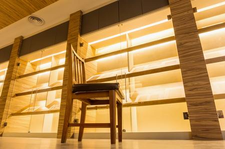 showroom: wood chair in the warm light showroom