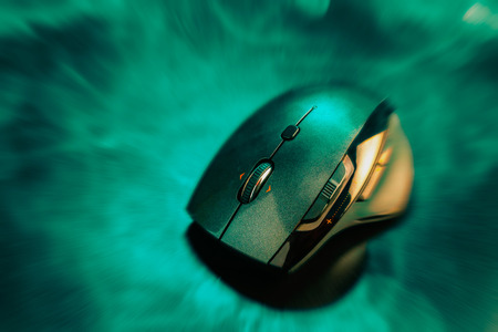 High technology computer gaming mouse in dark green and yellow hilight with zmoke and zoom out effect  Stock Photo