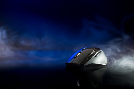 scrollwheel: High technology computer gaming mouse in dark blue tone with smoke Stock Photo