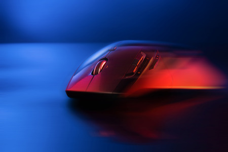 High technology computer gaming mouse fast moving  in blue tone