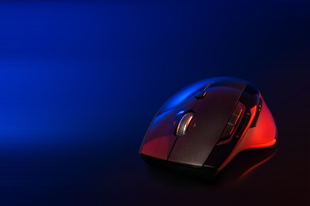 High technology computer gaming mouse in blue tone with reflaction Stock Photo