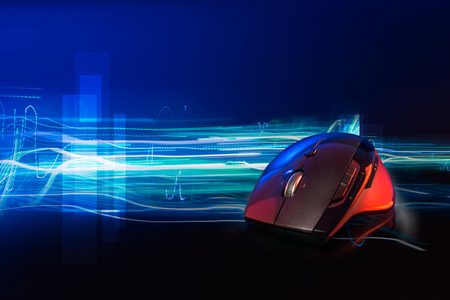 High technology computer gaming mouse fast moving  in blue tone with stroke of lightning as background