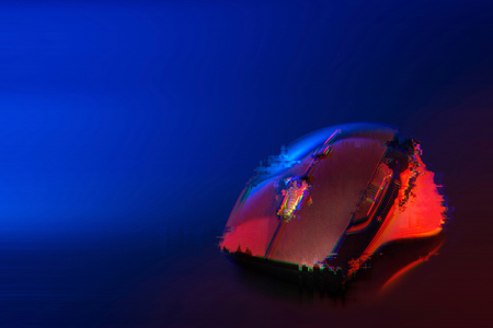 Glitch effect of High technology computer gaming mouse in blue tone with reflaction Stock Photo